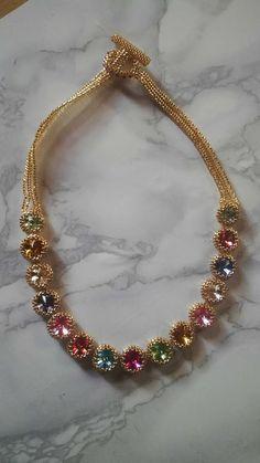 Swarovski crystals bezeled with Miyuki golden delica beads
