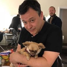 James Dean Bradfield holding Big Dave. In the background; Michael Hall.
