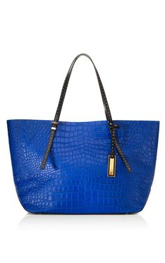 Love this color in a croc tote Michael Kors