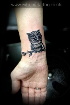 stimulating cute owl tattoo on wrist