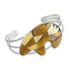 Eye of the Tiger stone combination features Sierra Nevada black jade, tiger eye and mother of pearl to produce these dramatic, golden tones. The band is solid sterling silver and is polished to a gleaming finish with no rough edges.