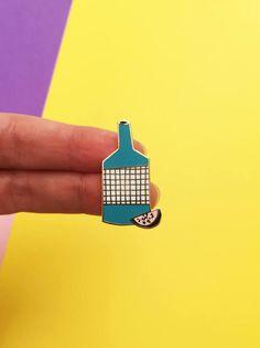 A enamel pin of a fruity bottle by weareoutofoffice on Etsy