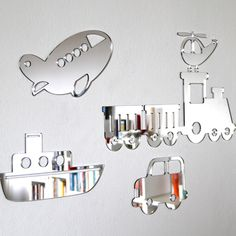 TRANSPORT MIRROR SET - Let your imagination run wild with this cute transport mirror set that comes complete with removable adhesive. These shatterproof mirrors are handmade from mirror finish Perspex and won't leave marks on the wall. The train is 410 x 160 mm; the boat is 220 x 120 mm; the car is 160 x 150 mm; the plane is 210 x 120 mm and the helicopter is 135 x 90 mm.