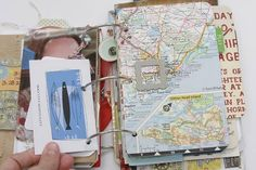 I go back and forth about scrapbooking.  I don't want to buy all the cutesy stamps and whatnot, but I like to journal a bit/save things when I travel so I can look back at them later.  I like the three ring binding she uses here, though I'll never get this detailed myself.