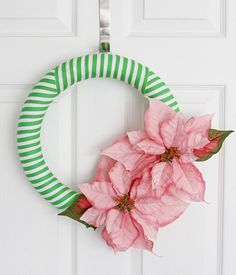If poinsettias are your favorite winter flower, then you'll love this Poinsettia Striped DIY Wreath.