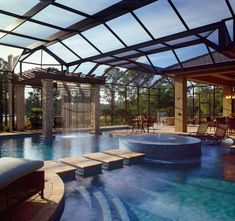 Incredible outdoor living and pool area! Arthur Rutenberg Homes http://www.houzz.com/projects/581128/wooded-Florida-home