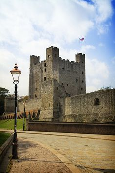 Rochester Castle, Kent. Its Norman tower-keep of Kentish ragstone was built about 1127 by William of Corbeil, Archbishop of Canterbury, with the encouragement of Henry I. Consisting of three floors above a basement, it still stands 113 feet high. Attached is a tall protruding forebuilding, with its own set of defences to pass through before the keep itself could be entered at first floor level. In 1215, garrisoned by rebel barons, the castle endured an epic siege by King John. Having first undermined the outer wall, John used the fat of 40 pigs to fire a mine under the keep, bringing its southern corner crashing down. Even then the defenders held on, until they were eventually starved out after resisting for two months. Rebuilt under Henry III and Edward I, the castle remained as a viable fortress until the sixteenth century.