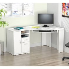 Save space in your home office with this stylish Inval corner desk. Constructed with solid composite wood, the desk has a white melamine finish for added durability. The desk features two open storage                                                                                                                                                      More