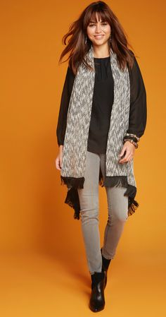 An adorable fringe sweater vest is all you need to enhance your look.