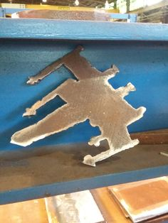 This welder had about an hour of downtime so he cut an x-wing out of a steel plate