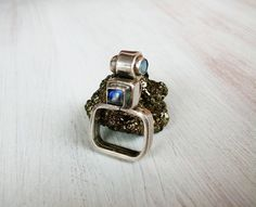 Size: 8    This very original ring has been created in our home studio while living in Tulum, Mexico.    Gemstone has very luminescent colors; central