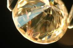 A fracture filled diamond showing flashes of orange