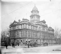 Denver, formerly Arapahoe, County Courthouse located at 15th (Fifteenth) and 16th (Sixteenth) Streets and Tremont and Court Places in downtown Denver, Colorado. Pedestrians and buggies are on the streets around the courthouse.  Date  [between 1890 and 1910]  :: History Colorado