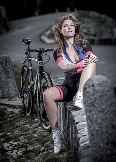 Gorgeous cycling girl in artistic photo. Very nice