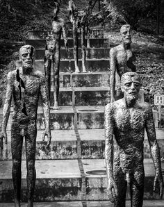 The Memorial to the victims of Communism (Czech: Pomník obětem komunismu) is a series of statues in Prague commemorating the victims of the communist era between 1948 and 1989. It is located at the base of Petřín hill, Újezd street in the Malá Strana or the Lesser Town area.   It was unveiled on the 22 May 2002, twelve years after the fall of communism, and is the work of Czech sculptor Olbram Zoubek and architects Jan Kerel and Zdeněk Holzel. It was supported by the local cou...