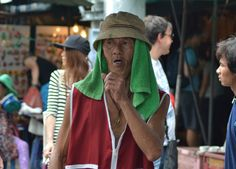 Local worker coughing up chunks. Exploring the labyrinth of JJ Market in Bangkok, Thailand. Chatuchak Weekend Market. For full blog on JJ Market Bangkok check our blog http://live-less-ordinary.com/southeast-asia-travel/jj-market-bangkok-chatuchak-weekend