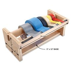 DIY Tip of the Day: Tape Dispenser Caddy. Keep your tape rolls in one place with this handy tape dispenser. You'll need a 1 1/2-in. dowel, 3/4-in. plywood and a hacksaw blade. Notch the sides and screw everything together. Saw the dowel ends to fit in the notches and screw the hacksaw blade on with the teeth overhanging the plywood. Fasten the dispenser to the workbench. Thanks to R. B. Himes for this idea!