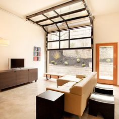 keep garage door for industrial feel; lighting and air - in garage to living room conversion