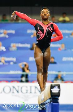 Simone Biles Makes History in Pink and Black Under Armour Competitive Leotard at 2014 World Championship | GK Elite