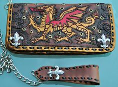 Premium goat leather Welsh Dragon Biker Wallet.  Interior lined with pig skin, 10 card holders and 2 cash pockets.  Comes with 22 inch chain and leather belt adaptor.  Made from start to finish by one man.  Wearable art and heirloom.  Not mass produced cookie cutter junk.  Absolutely no fillers in any of my products.  All of it is premium leather - inside and out!