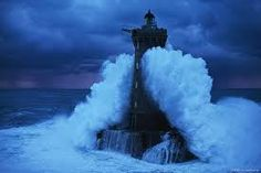 Image result for huge waves and lighthouses
