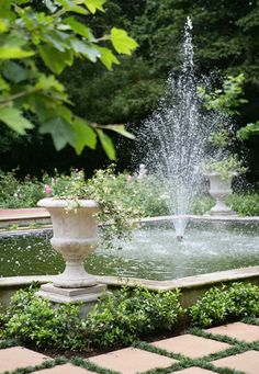 Formal Italian Style Pond with Water Features and Sculpted Gardens.