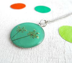 pressed flowers in resin jewelry