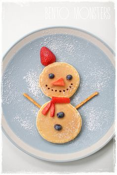 Snowman pancakes.... use cut bacon strips for arms and mini chocolate chips for his smile
