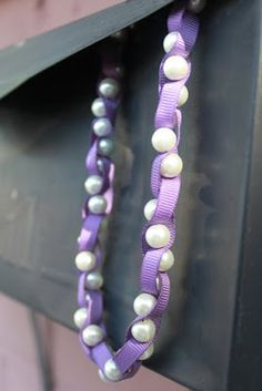 Free tutorial for a Ribbon Pearl Necklace. Beautiful handmade jewelry that you will be proud to show off. DIY Do it yourself and see what you can make.