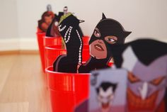 This game was for a Batman party, but could do most any theme idea...could even change to cans and have kids knock cans down instead of getting ball in a cup