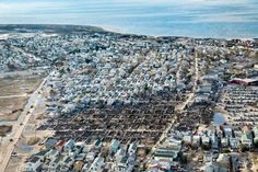 Stephen Wilkes for TIME  On the night Sandy made landfall, a fire swept through this community on the tip of the Rockaway Peninsula, consuming more than 100 homes, Breezy Point, N.Y., 2012  Hurricane Sandy, One Year Later: Self-Portraits by Communities in Distress - LightBox
