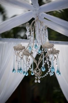 chandelier adds some glamour to the wedding canopy.
