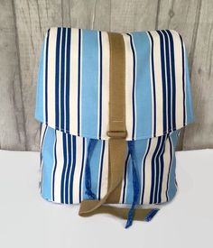 A canvas backpack in a blue deck chair stripe fabric. Perfect for holidays or use as a diaper bag Personalized Tote Bags, Custom Tote Bags, Striped Backpack, Backpack Pattern, Striped Canvas, Deck Chairs, News Boy Hat, Canvas Backpack, Striped Fabrics