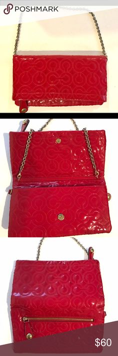 """Coach red patent leather fold-over purse Coach red patent leather fold-over purse.  Removable chain strap.  Size is like a large wallet, but top folds down and closes with magnetic button.  Top zips open to large interior space.  Inside wallet portion there are 6 credit card slot.  Zipper pocket on back.  Measure 5"""" tall x 8.5"""" wide when folded.  Open, 8"""" tall. 7"""" strap drop.  **Please note, there are some signs of wear.  Minor scuffing on front. No rips, tears or fabric issues.  Good used…"""