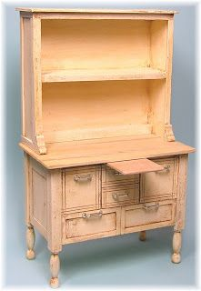 "kitchen cabinet from matboard, 1/4 sq stripwood, 3/32 thick basswood, legs from tiny turning #3000, handles from #15 wire/2 seed beads/1/4"" bugle bead, 13/32 colonial moulding"