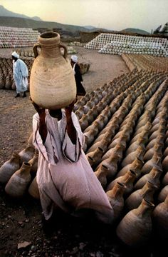 Deir el-Gharbi village in Egypt, where residents craft jugs made of desert clay.    National Geographic, December 1991