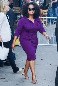 You know I love purple and Ms. Winfrey is working that dress.