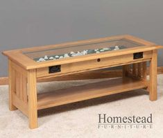 (Not this one exactly but one similar to it). Glass top coffee table with storage space to display momentos. Needs to be a half inch deep, just want to display pictures mostly.  A black finish or espresso color would be ideal.