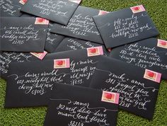 Black envelopes with white lettering. Def won't lose this invite!