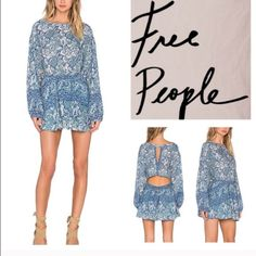 Free People Blue Printed Dress NWT Elevated by a flattering blouson top and cutout back, this frock makes an unforgettable statement. An elastic waistline finishes the piece for the ultimate in comfort and trend-right flair. There is a slight tear in the fabric on the left but honestly, it is hardly noticeable if you have it on and it would be a quick fix from someone who has sewing skills! •Approximately 36-in. • Back 3-button closure • Boat neckline; Cutout back • Long blouson sleeves •…