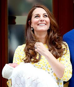 Kate Middleton and her perfect mane stood outside St. Mary's Hospital in London to present baby Charlotte to the world on May 2.