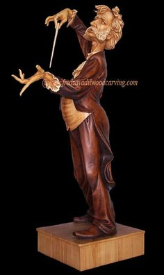 Caricature carving of an opera conductor - Maestro, wood carving by Fred Zavadil
