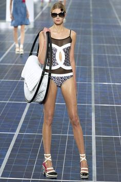 I usually hate how Chanel is obsessed about their logo and wanting to put it everywhere but I actually love this bathing suit.