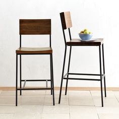 Rustic yet refined, these stools' owe their distinctive good looks to the rich grain and warm, inviting color of solid acacia wood. Raw steel legs add industrial style.