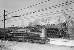 renumbered from 4899 but still wearing its original striping, stands beside Pacific 5426 at Zoo interlocking, Philadelphia, on November Electric Locomotive, Steam Locomotive, 30th Street Station, Long Island Railroad, New York Central Railroad, Pennsylvania Railroad, Railroad Photography, Old Trains, Train Pictures