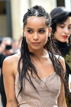 Zoe Kravitz from Hot Hair Trends for Summer 2016 For an undone look, follow the lead of the actress who pulled her mixed texture braids up into a cool half-up 'do.
