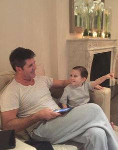 Simon Cowell posted this picture last month of him relaxing with son, Eric, in his £10m Ho...