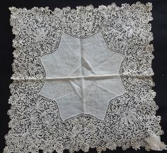 a 19th century Honiton lace handkerchief.