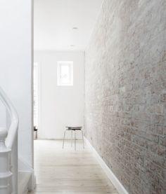 brick wall + wooden floors.