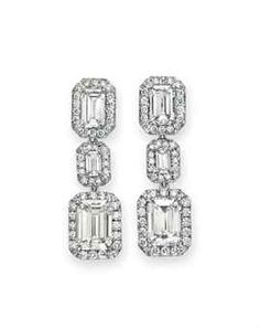 A PAIR OF DIAMOND EAR PENDANTS Each suspending a rectangular-cut diamond, weighing approximately 3.04 and 3.01 carats, within a circular-cut diamond surround on the obverse and reverse, joined by a rectangular-cut diamond within a circular-cut diamond surround, to the surmount set with a rectangular-cut diamond, weighing approximately 1.19 and 1.05 carats, within a circular-cut diamond surround, mounted in platinum.